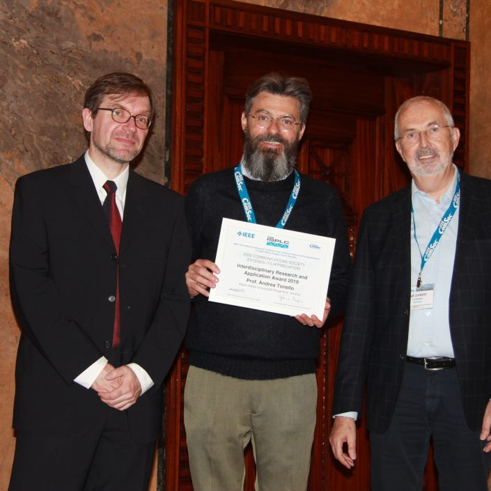 in the photo: Ralf Lehnert (awards committee chair, right), Andrea Tonello (middle), Jaromír Hrad (ISPLC 2019 general chair, left) at the ceremony in Prague at IEEE ISPLC on 4.3.2019.