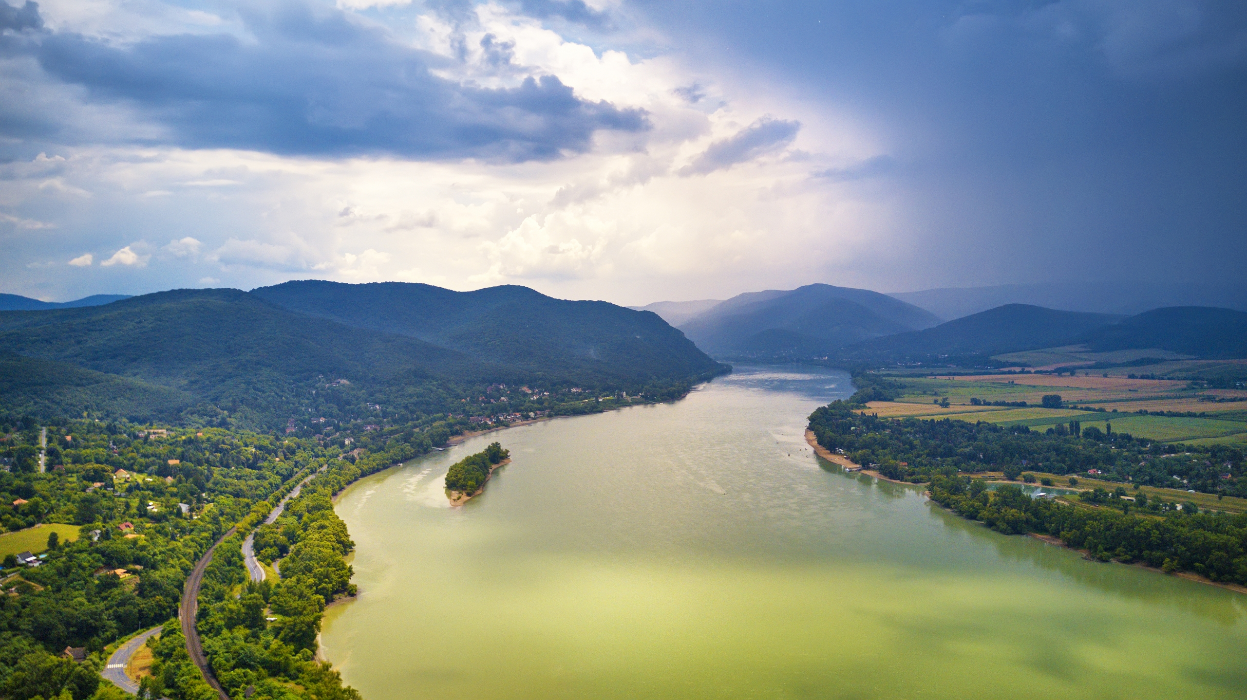 Summer rain and stormy weather. Danube river valley panorama.