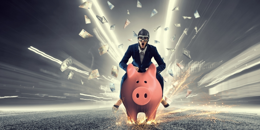 Young businesswoman riding on piggy bank, isolated on white.